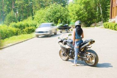 brunette woman sit on sports motorcycle