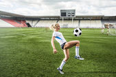 Photo girl playing football