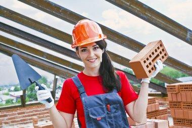 woman mason hold red brick