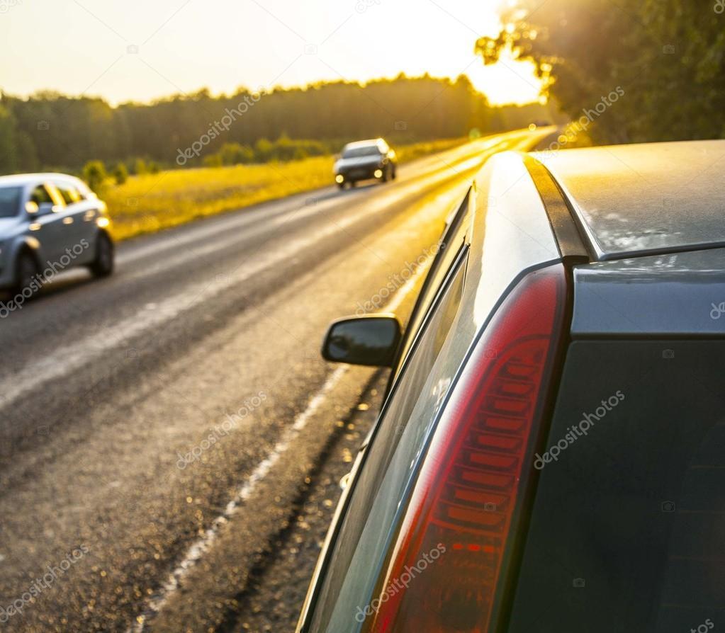 car  near asphalt highway