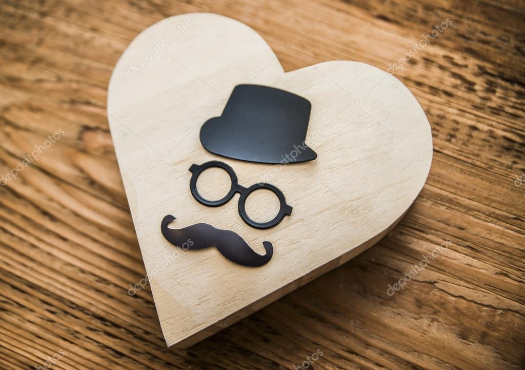 Happy fathers day sticker wooden glasses or sunglasses black mustache and hat on wooden heart sign symbol background idea of happy fathers day photo