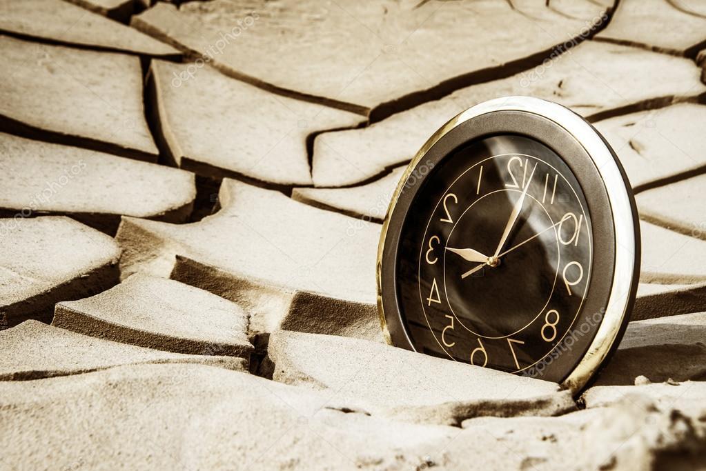 clock on cracked dry soil