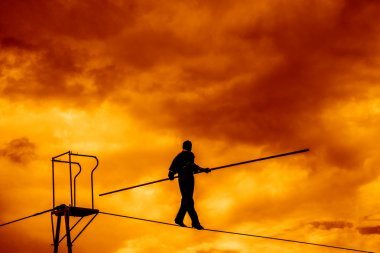 Silhouette of Equilibrist businessman