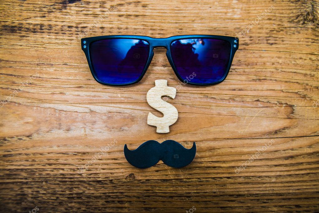 Happy fathers day sticker summer sunglasses dark blue glasses black paper mustache and dollar sing on wooden background photo by borjomi88