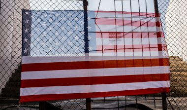 American flag in front fence and stairway