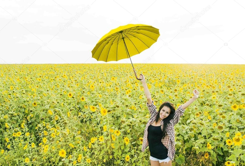 Woman with yellow Umbrella standing