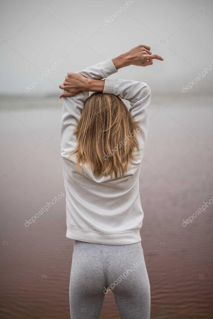 woman stretching arms up