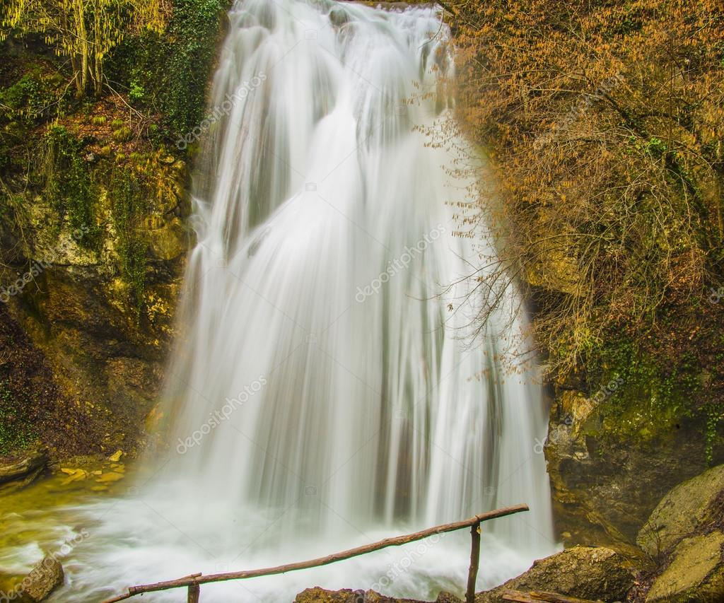 waterfall in autumn  wild forest
