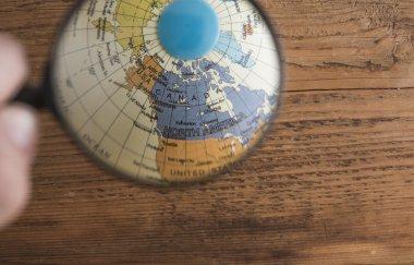 Magnifying lens enlarging globe