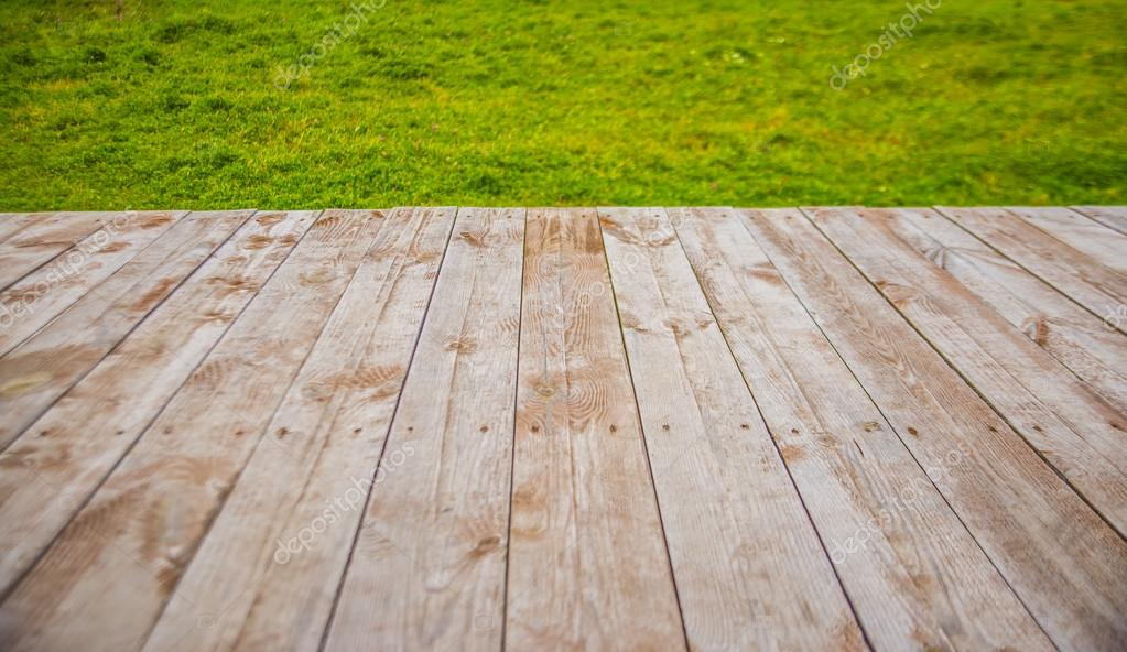 Wooden table on  green grass