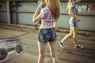 Two beautiful girls walking