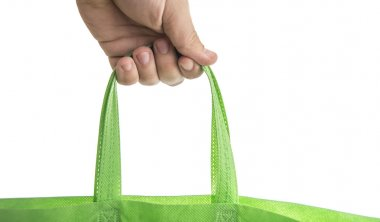 man holding green Fabric tote