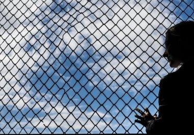 woman silhouette standing  near  Net