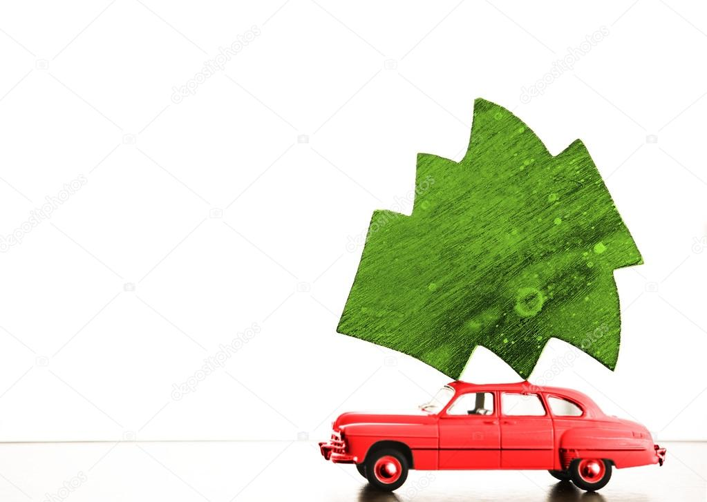 car carrying wooden Christmas tree