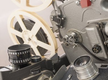 Vintage cameras with reel and film projector