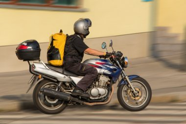 Busy messenger on motorcycle