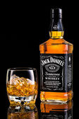 Jack Daniels whiskey bottle and glass