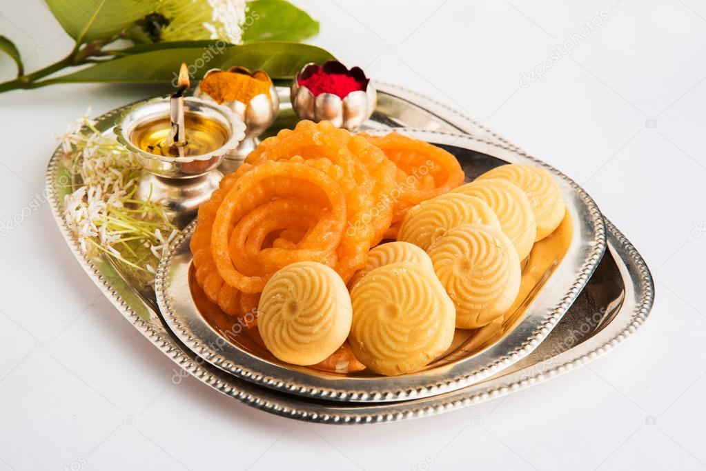 Beautifully Decorated Pooja Thali for diwali celebration or worship  having Indian sweets silver l& flowers huldi or turmeric powder and kumkum in a ... & Beautifully Decorated Pooja Thali for diwali celebration or worship ...