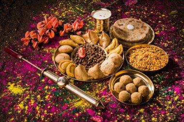 Holi festival food with colours, indian festival holi, samosa, kachori, laddu, gujiya, palash flower, thandai, farsan, puran poli or roti, indian festival of colours called holi stock vector