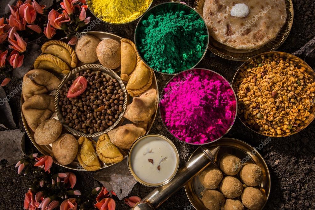 Holi festival food with colours, indian festival holi, samosa, kachori,  laddu, gujiya, palash flower, thandai, farsan, puran poli or roti, indian  festival of colours called holi ⬇ Stock Photo, Image by ©