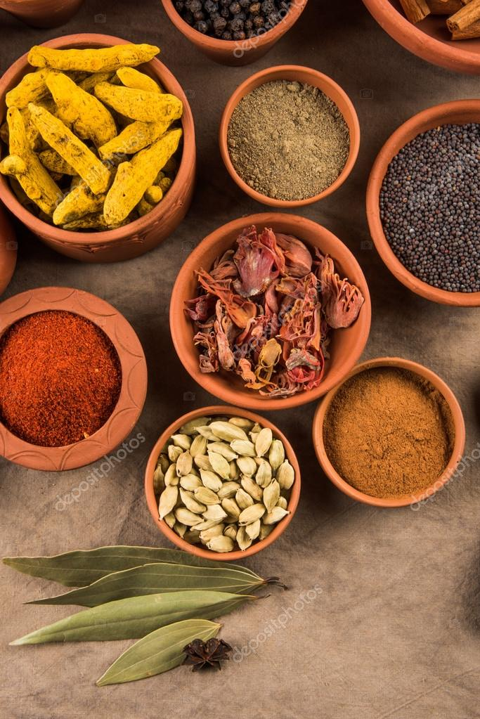 Indian spices in terracotta pots, indian colourful spices