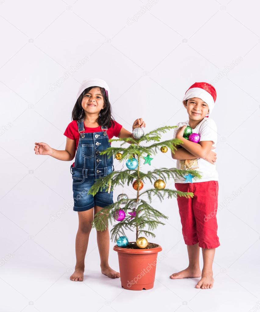 two indian kids and christmas, asian kids with christmas gifts ...