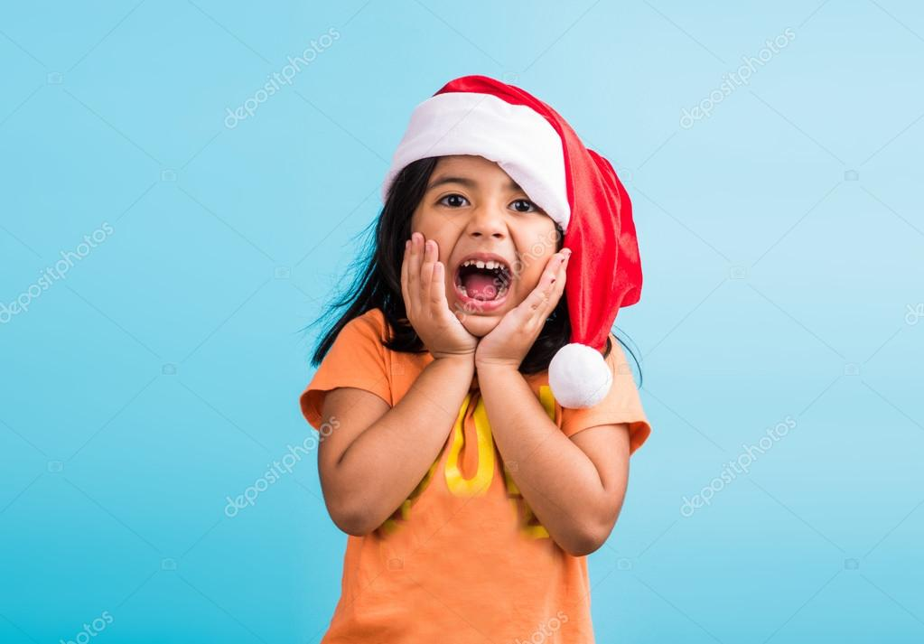 Small Cute Indian Girl With Christmas Hat Thinking Indian Girl And