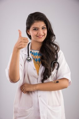 smiling indian doctor with stethoscope, woman health care professional giving OK sign, isolated, Positive face expression, emotion attitude, indian or asian confident female doctor