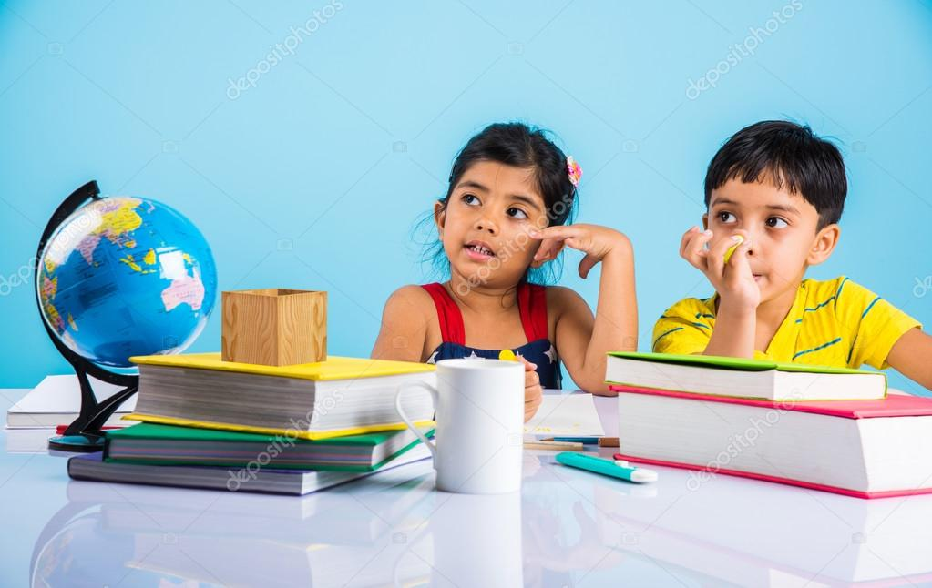 indian boy and girl studying with globe on study table asian kids