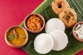 food South Indian food idli vada with sambar on a banana leaf