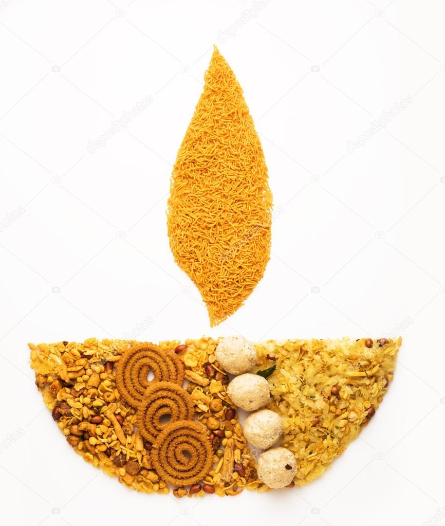 Traditional indian diwali snack or diwali food in diwali lamp form traditional indian diwali snack or diwali food in diwali lamp form isolated on white diwali greeting card creative diwali concept photo by subodhsathe m4hsunfo