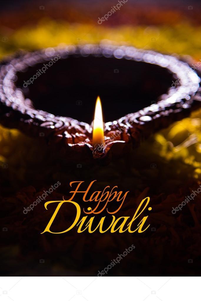 Happy diwali greeting card made using a traditional indian earthen happy diwali greeting card made using a traditional indian earthen lamp placed over marigold petals rangoli m4hsunfo