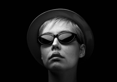 Undercover blonde woman with glasses
