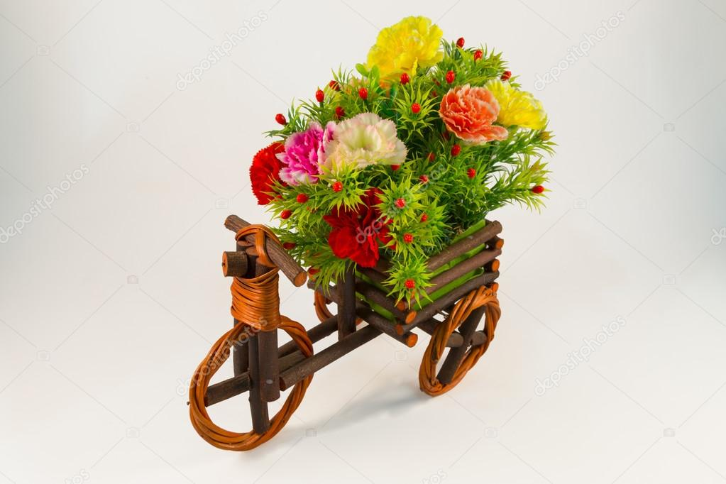 Beautiful and colorful flower bouquet in wooden basket in car sh ...
