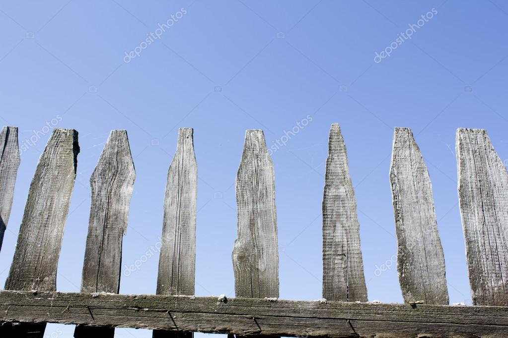 Wooden fence against the blue sky. Background.