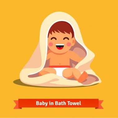 Happy baby boy toddler wrapped in bath towel