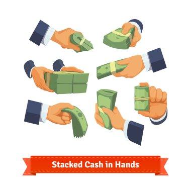 Hands showing green cash stacks