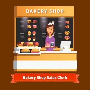 Shop assistant woman serving cake