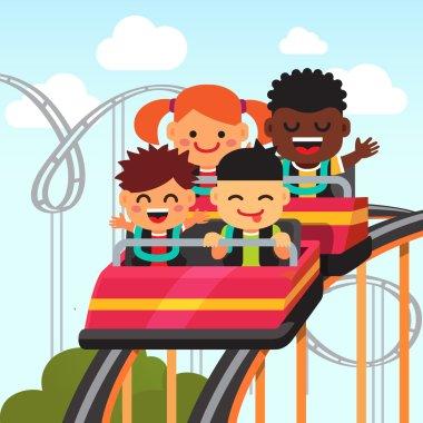 smiling kids riding roller coaster