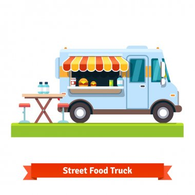 Opened street food truck with table