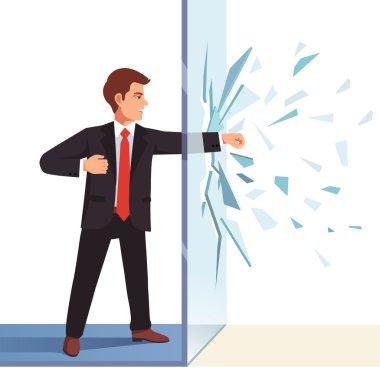 Businessman breaking  glass wall