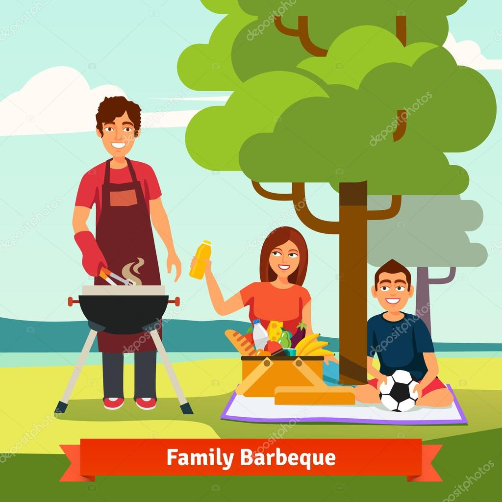 Family on vacation having outdoor bbq