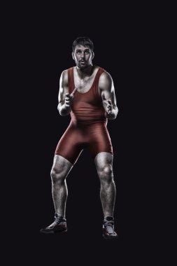 Freestyle wrestler in red uniform