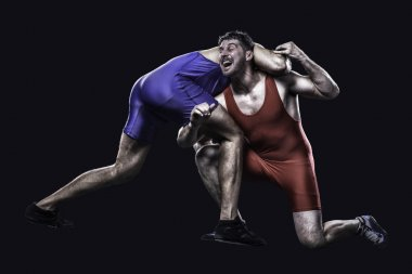Two freestyle wrestlers in action