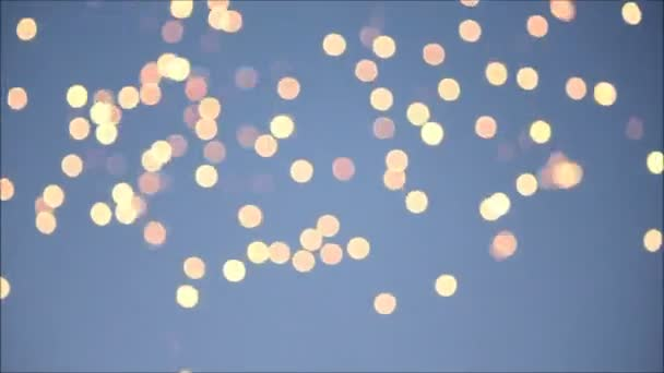 Blurred sparks and fireworks on blue sky background