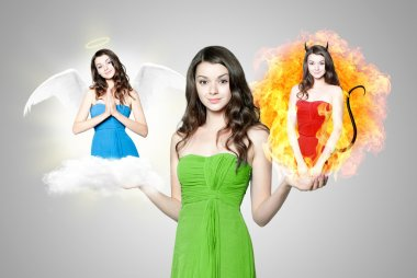 Beautiful young brunette woman choosing between angel and devil