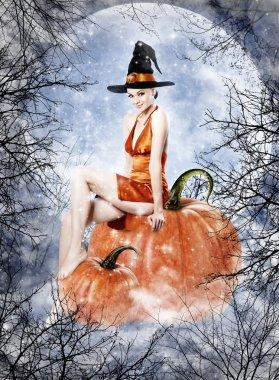 Beautiful brunette woman as halloween witch