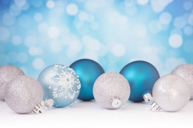 Blue and silver Christmas scene with baubles