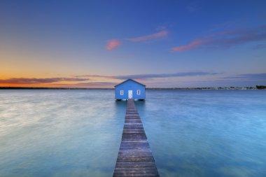 Sunrise over the Matilda Bay boathouse in the Swan River in Perth, Western Australia. stock vector