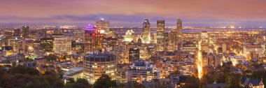 The skyline of downtown Montreal, Quebec, Canada from the top of Mount Royal. Photographed at dusk. stock vector